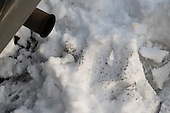 A diesel van's exhaust impurities show up on the snow.