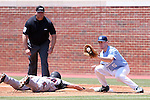07 May 2016: Louisville's Blake Tiberi (26) dives back to first base beating the throw to North Carolina's Brooks Kennedy (5). The University of North Carolina Tar Heels played the University of Louisville Cardinals in an NCAA Division I Men's baseball game at Boshamer Stadium in Chapel Hill, North Carolina.