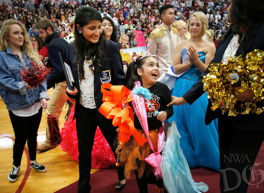 "NWA Democrat-Gazette/DAVID GOTTSCHALK   Andrea ""Isa"" Perez, a first grade student from Tyson Elementary School, is Friday, November 6, 2015,surprised when she receives a trip to Disney World during a special event pep rally at Springdale High School. Isa received the trip through the Make A Wish Foundation Mid-South Chapter with funds raised by the student organization DECA at the High School."