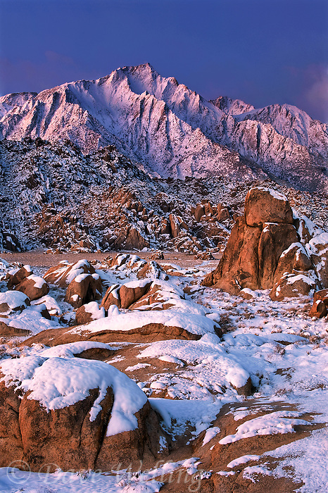 711700249 winter sunrise over snow covered granite boulders with lone pine peak in the background in the alabama hills in the eastern sierras kern county california