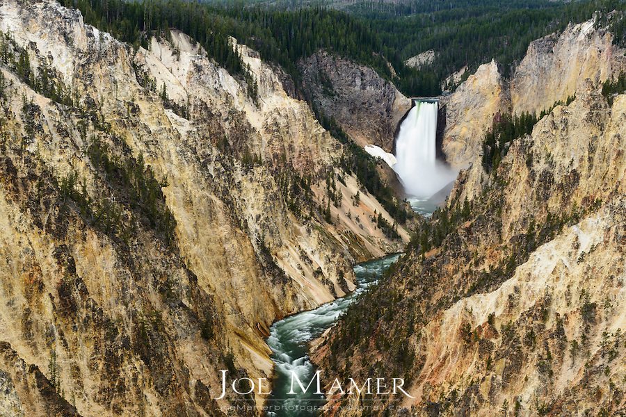 The Lower Falls of the Yellowstone River flows through the Grand Canyon of the Yellowstone.