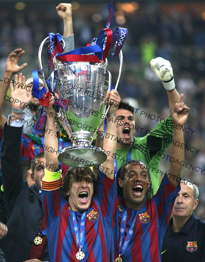 Spanish player and captain of Barcelona hold the trophy winner of the Champioship league, and celebrate with Brazilian player Ronaldinho (right), and goalkeeper Victor Valdes (above)&amp;#xA; Spanish team Barcelona and English team Arsenal play for the Champions League Final, Wednesday May 17, Paris, France. photo: Srdjan Stevanovic<br />