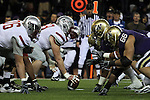 "The Washington State offensive line prepares to take on the Husky defensive line the moment the Cougars center, Kenny Alfred (#69), snaps the ball during the Cougars Pac-10 conference ""Apple Cup"" showdown with arch-rival Washington at Husky Stadium in Seattle, Washington, on November 28, 2009.  Also visible in the pre-snap snapshot are Washington State's Micah Hannam (#76) and Washington's defensive end, Daniel Te'o-Nesheim (#66).  The Cougars lost to the Huskies in the game, 30-0."