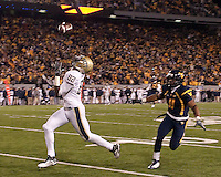 Pittsburgh wide receiver Jonathan Baldwin makes a 50-yard touchdown catch as as WVU defensive back Sidney Glover (11) can't keep up. The West Virginia Mountaineers defeated the Pittsburgh  Panthers 19-16 on November27, 2009 at Mountaineer Field at Milan Puskar Stadium, Morgantown, West Virginia.