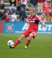 Chicago midfielder Jeff Larentowicz (20) passes the ball.  The Chicago Fire defeated the New York Red Bulls 3-1 at Toyota Park in Bridgeview, IL on April 7, 2013.