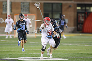College Park, MD - April 29, 2017: Maryland Terrapins Matt Neufeldt (28) holds off a Johns Hopkins Blue Jays defender during game between John Hopkins and Maryland at  Capital One Field at Maryland Stadium in College Park, MD.  (Photo by Elliott Brown/Media Images International)