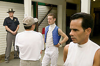 Jockey Julien Leparoux (2R) talks to his agent Steve Bass (2L) between races in the jockeys' quarters in Saratoga Springs, NY, United States, 4 August 2006.