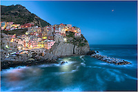 Looking back at Manarola, Italy, I am always fascinated by the view. On this sleepy night in the Cinque Terre, I shot a long exposure of the town lit up by the moonlight and small town lights. This little village along the Ligurian Coast of Italy is one of my favorite places to both visit and photograph.