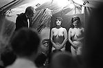 Pinner annual  Fair granted by Edward 111 in 1336. Middlesex. England 1971. Strip tease tent. It's the end of the show the girls are about to leave the tiny stage; the curtain is drawn back Humphrey Bogart eye looks on.<br />