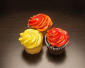 Orange and yellow cupcakes with frosting