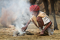 Making Fire. A scene from the Pushkar Camel Fair 2013, Rajasthan, India.