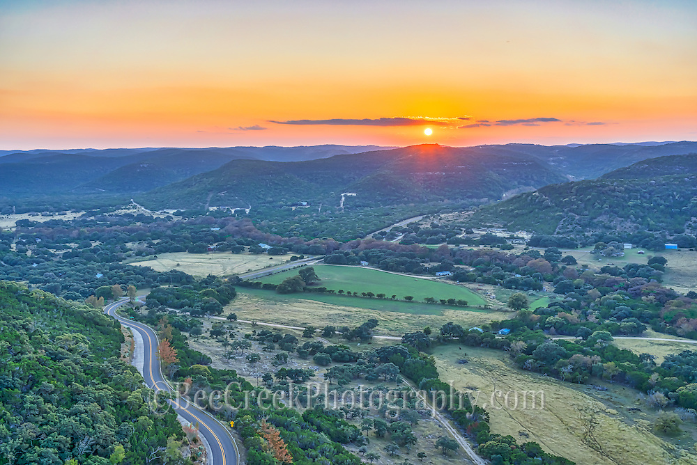 We captured this aerial image of the sunset in the Texas Hill Country near Vanderpool. Just thought it was so pretty here with valleys and hills through out. Motorcyclist like to travel the twisted roads below,  this is part of what is called the twisted sisters since they wind through out the hills of the western hill country which is very rugged. However many people have died along this stretch so be careful. Most people don't realize how diverse and awesome Texas scenery can be.