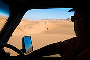 Vehicles in sand dunes, Namib-Naukluft National Park, Namibia