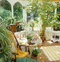 Intimate seating area in a sunlit corner of a conservatory