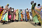 Women line up for food being distributed by the United Nations World Food Program in Agok, a town in the contested Abyei region where tens of thousands of people fled in 2011 after an attack by soldiers and militias from the northern Republic of Sudan on most parts of Abyei. Although the 2005 Comprehensive Peace Agreement called for residents of Abyei--which sits on the border between Sudan and South Sudan--to hold a referendum on whether they wanted to align with the north or the newly independent South Sudan, the government in Khartoum and northern-backed Misseriya nomads, excluded from voting as they only live part of the year in Abyei, blocked the vote and attacked the majority Dinka Ngok population. The African Union has proposed a new peace plan, including a referendum to be held in October 2013, but it has been rejected by the Misseriya and Khartoum. The Catholic parish of Abyei, with support from Caritas South Sudan and other international church partners, has maintained its pastoral presence among the displaced and assisted them with food, shelter, and other relief supplies.