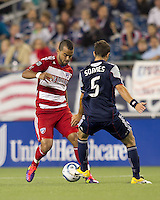 FC Dallas forward Maicon Santos (9) dribbles as New England Revolution defender A.J. Soares (5) defends. In a Major League Soccer (MLS) match, the New England Revolution defeated FC Dallas, 2-0, at Gillette Stadium on September 10, 2011.