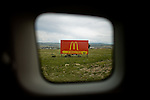 Travel scenes of Wyoming through the window of a rented Mazda M5...A sign advertising McDonalds near Rawlins, Wyoming.