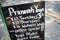 Yoga studio advertises their classes on a chalkboard in New York on Sunday, June 26, 2016. (© Richard B. Levine)