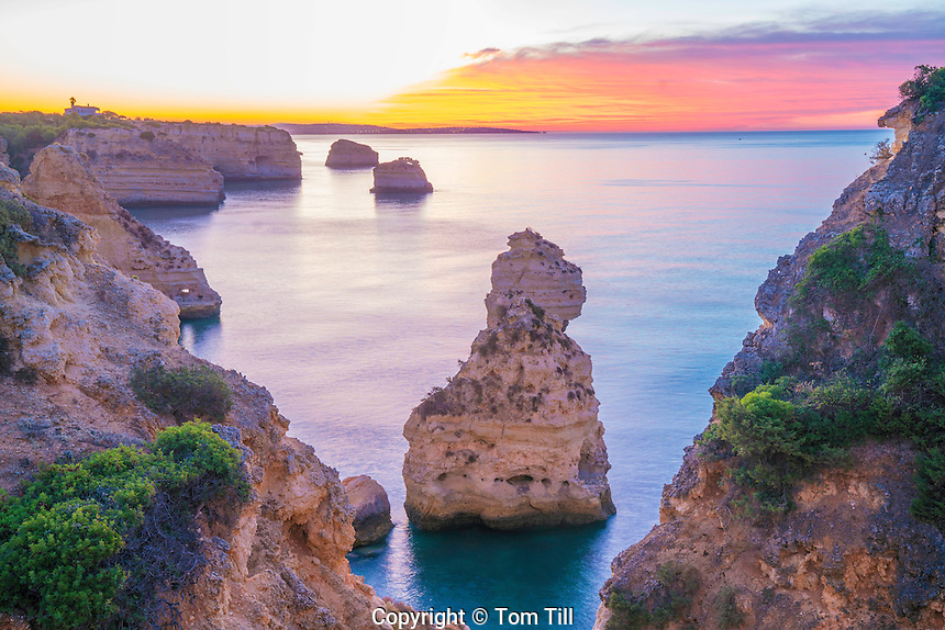 Sea stacks at sunrise on Algrave Coast, Portugal, Atlantic Ocean   Near Lagoa
