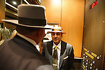 Dukey is dressed up for an Orthodox pumana, a ceremony celebrating the life of one of his family who died, six month after their funeral. Kalderash Roma, whose forefathers travelled to the United States after being liberated from slavery during the mid nineteenth century in Romania. A Dallas hotel, Texas USA 2006