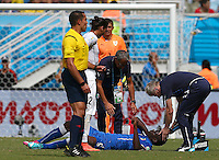 Mario Balotelli of Italy receives treatment for a head injury