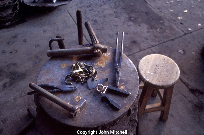 Coppersmith's tools at a workhop in the village of Santa Clara del Cobre near Lake Patzcuaro, Michoacan, Mexico