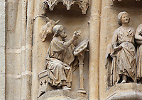 Figure, possibly a scribe, with a bull's head, on one of the left-hand archivolts of the tympanum of the South portal or St Honore portal on the South transept of the Basilique Cathedrale Notre-Dame d'Amiens or Cathedral Basilica of Our Lady of Amiens, built 1220-70 in Gothic style, Amiens, Picardy, France. St Honore or Honoratus was the 7th bishop of Amiens who lived in the 6th century AD. Amiens Cathedral was listed as a UNESCO World Heritage Site in 1981. Picture by Manuel Cohen