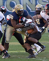 Pitt nose tackle Tyrone Ezell (50) makes a tackle. The Pitt Panthers defeated the Gardner-Webb Runnin Bulldogs 55-10 at Heinz Field, Pittsburgh PA on September 22, 2012..