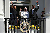(L to R)  First lady Michelle Obama , Pope Francis and U.S. President Barack Obama wave from the balcony during an arrival ceremony at the White House on September 23, 2015 in Washington, DC. The Pope begins his first trip to the United States at the White House followed by a visit to St. Matthew's Cathedral, and will then hold a Mass on the grounds of the Basilica of the National Shrine of the Immaculate Conception. <br /> Credit: Win McNamee / Pool via CNP
