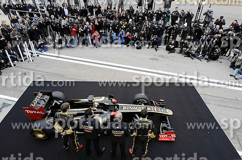 31.01.2011, Street Circuit, Jerez, ESP, Formel 1, Tests Valencia 2011, Tag 1,  im Bild  Lotus Renault GP R31 Launch 2011 - Robert Kubica (POL), Lotus Renault GP - Vitaly Petrov (RUS), Lotus Renault GP - Eric Boullier (FRA), Team Chef Renault F1 Team. EXPA Pictures © 2011, PhotoCredit: EXPA/ NPH/ Dieter Mathis     ****** out of GER / SWE / CRO  / BEL ******