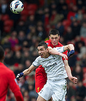 LIVERPOOL, ENGLAND - Easter Monday, April 1, 2013: Liverpool's Lloyd Jones in action against Tottenham Hotspur's Nabil Bentaleb during the Under 21 FA Premier League match at Anfield. (Pic by David Rawcliffe/Propaganda)