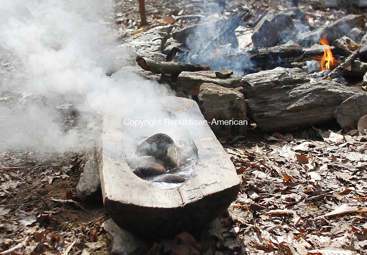 WASHINGTON, CT-17 FEBRUARY 2012 021712JW09 - Rocks heated in a fire pit and dropped into a wooden bowl filled with maple tree sap causes the sap to boil condensing it to maple syrup at Washington's Institute for American Indian Studies during the Institute's Maple Sugaring event Saturday morning..Jonathan Wilcox Republican American..