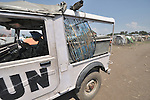 An Indian soldier, part of a United Nations peacekeeping contingent, drives through a camp in rebel-held territory in the eastern Congo. Families displaced by fighting between rebel Tutsi General Laurent Nkunda and the Congolese military took refuge in this camp they established in the shadow of the UN base in the village of Kiwanja. According to aid workers and human rights groups, rebel soldiers executed some 150 people here in a 24-hour period in early November. The killings took place half a mile from the UN base, yet the 120 UN peacekeepers, part of the largest UN peacekeeping contingent in the world, did not take any action to stop the violence. ...