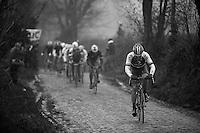 Dwars Door Vlaanderen 2013.Aleksejs Saramotins (LVA) trying to break away from the group to try and join race-leader Matt Hayman ahead