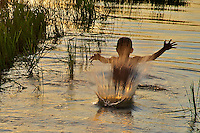 Children playing in the rice fields on the road to Battambang, Cambodia