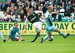 Hibs v St Johnstone...25.08.12   SPL.Paul Cairney's shot is blocked by Steven Anderson.Picture by Graeme Hart..Copyright Perthshire Picture Agency.Tel: 01738 623350  Mobile: 07990 594431