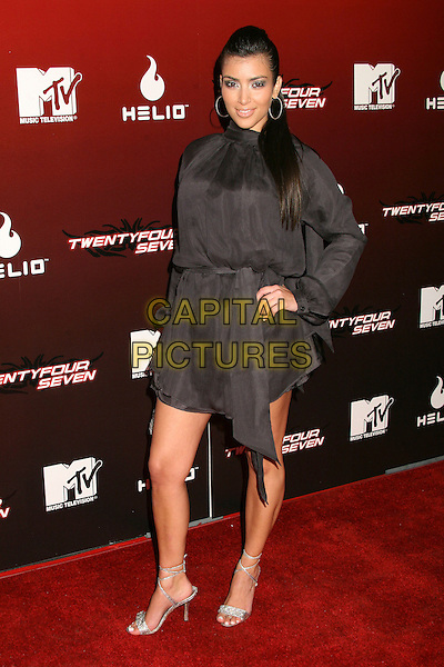 "KIM KARDASHIAN.MTV Series Premiere of ""Twentyfourseven"" at Area, .Los Angeles, California, USA,.29 November 2006..full length black dress hoop earrings.CAP/ADM/BP.©Byron Purvis/AdMedia/Capital Pictures."