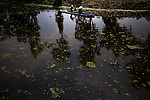 Farmers work on a canal in Xochimilco in Mexico city used to create fertile soil for intensive agriculture. The technique has remained the same since before the Aztecs.