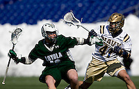 Stephen Murray (26) of Loyola tries to drive past Jordan Seivold (41) of Navy at the Navy-Marine Corp Memorial Stadium in Annapolis, Maryland.   Loyola defeated Navy, 8-7, in overtime.