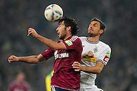 FUSSBALL   DFB POKAL   SAISON 2011/2012  ACHTELFINALE  Borussia Moenchengladbach - FC Schalke 04         21.12.2011 Raul (FC Schalke 04) gegen Martin Stranzl  (re, Borussia Moenchengladbach)
