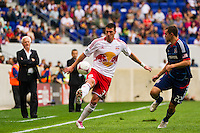Kenny Cooper (33) of the New York Red Bulls is marked by Austin Berry (22) of the Chicago Fire. The Chicago Fire defeated the New York Red Bulls 2-0 during a Major League Soccer (MLS) match at Red Bull Arena in Harrison, NJ, on October 06, 2012.