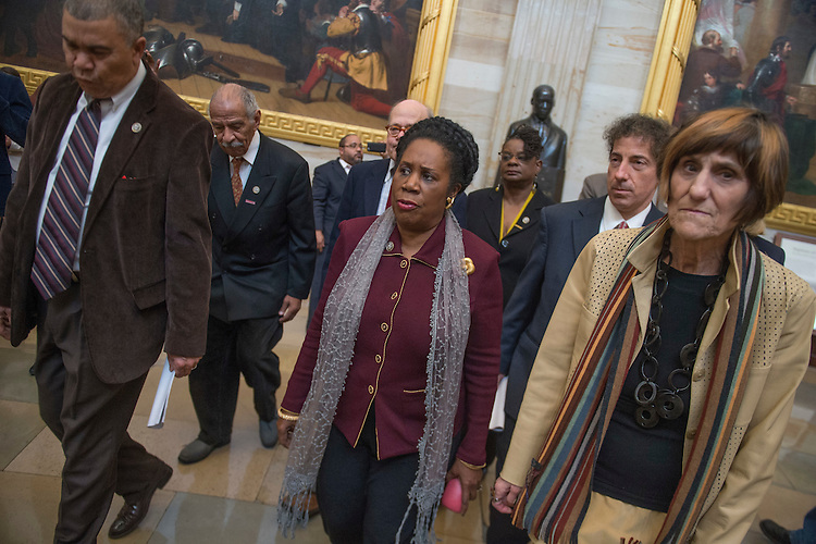 UNITED STATES - FEBRUARY 08: From left, Reps. Lacy Clay, D-Mo., John Conyers, D-Mich., Steve Cohen, D-Tenn., Sheila Jackson Lee, D-Texas, Gwen Moore, D-Wis., Jamie Raskin, D-Md., and Rosa DeLauro, D-Conn., visited the statue of Martin Luther King, Jr., in the Capitol rotunda before going to the Senate floor to protest the silencing of Sen. Elizabeth Warren, D-Mass., February 8, 2017. Warren read a 1986 letter by Coretta Scott King against attorney general nominee Jeff Sessions, R-Ala., when he was up for a federal judgeship. (Photo By Tom Williams/CQ Roll Call)