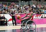 LONDON, ENGLAND 30/08/12: Abdi Dini competes in the Men's Wheelchair Basketball preliminary round CAN vs. JPN at the London 2012 Paralympic Games at the Basketball Arena (Photo by: Courtney Pollock/Canadian Paralympic Committee)