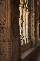 Intricately carved columns in the arcade of the Cloister, built in Manueline style by Diogo Boitac, Joao de Castilho and Diogo de Torralva, completed 1541, in the Jeronimos Monastery or Hieronymites Monastery, a monastery of the Order of St Jerome, built in the 16th century in Late Gothic Manueline style, Belem, Lisbon, Portugal. The cloister wings have wide arcades with rectangular column and tracery within the arches. The monastery is listed as a UNESCO World Heritage Site. Picture by Manuel Cohen