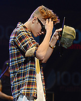 Justin Bieber performs onstage during the Y100's Jingle Ball 2012