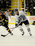 29 December 2007: Holy Cross Crusaders' forward Brodie Sheahan, a Sophomore from Lethbridge, Alberta, in action against the University of Vermont Catamounts at Gutterson Fieldhouse in Burlington, Vermont. The Catamounts rallied in the final seconds of play to tie the game 1-1. After overtime, although the official result remained a tie game, the Cats moved up to the championship round by winning a sudden death shootout in the second game of the Sheraton/TD Banknorth Catamount Cup Tournament...Mandatory Photo Credit: Ed Wolfstein Photo