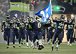 Seattle Seahawks run onto the field during team introductions before their game against the Carolina Panthers at CenturyLink Field in Seattle, Washington on December 4, 2016.  Seahawks beat the Panthers 40-7.  ©2016. Jim Bryant photo. All Rights Reserved.