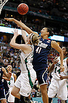 01 APRIL 2012:  Kiah Stokes (41) of the University of Connecticut blocks the shot of Natalie Novosel (21) of the University of Notre Dame during the Division I Women's Final Four Semifinals at the Pepsi Center in Denver, CO.  Notre Dame defeated UCONN 83-75 to advance to the national championship game.  Jamie Schwaberow/NCAA Photos