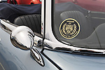 This side view mirror and decal close up is of 1967 E Type Jaguar 4:2 Series 1, at the 58th Annual Easter Sunday Vintage Car Parade and Show sponsored by the Garden City Chamber of Commerce. Hundreds of authentic old motorcars, 1898-1988, including antiques, classic, and special interest participated in the parade.