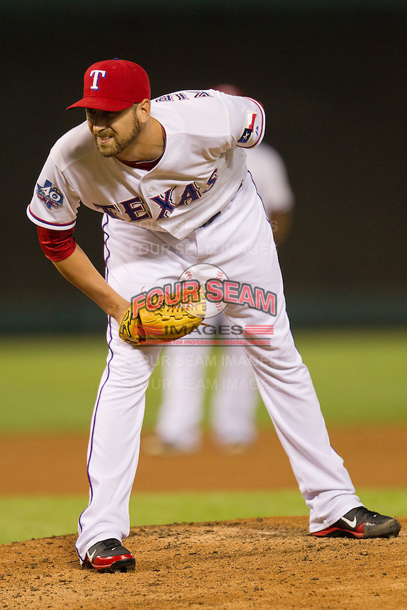 Texas Rangers pitcher Michael Kirkman #50 looks in for the sign during the Major League Baseball game against the Baltimore Orioles on August 21st, 2012 at the Rangers Ballpark in Arlington, Texas. The Orioles defeated the Rangers 5-3. (Andrew Woolley/Four Seam Images).